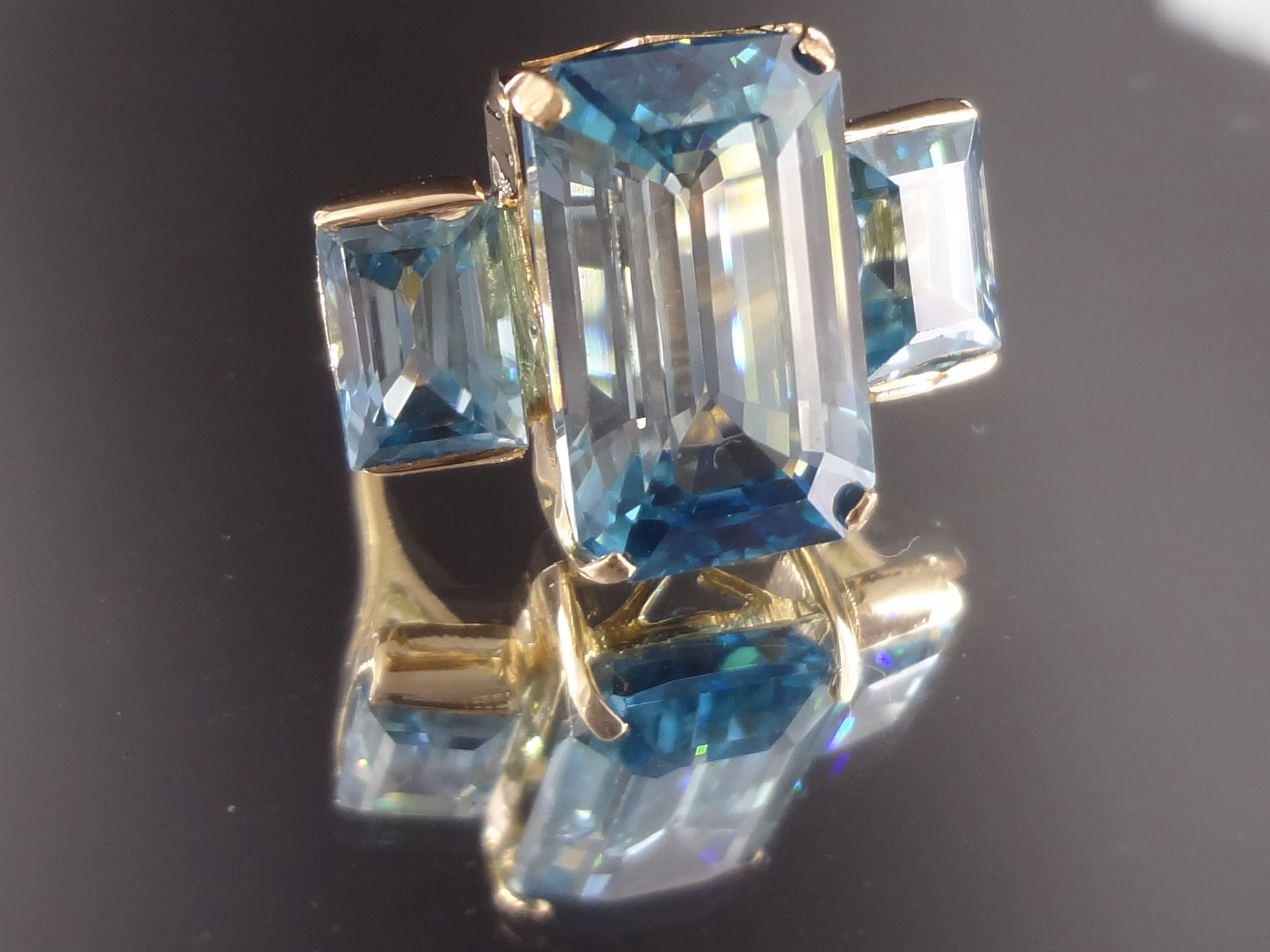 Purchase large emerald cut blue Zircon bi-color gemstone white and blue.