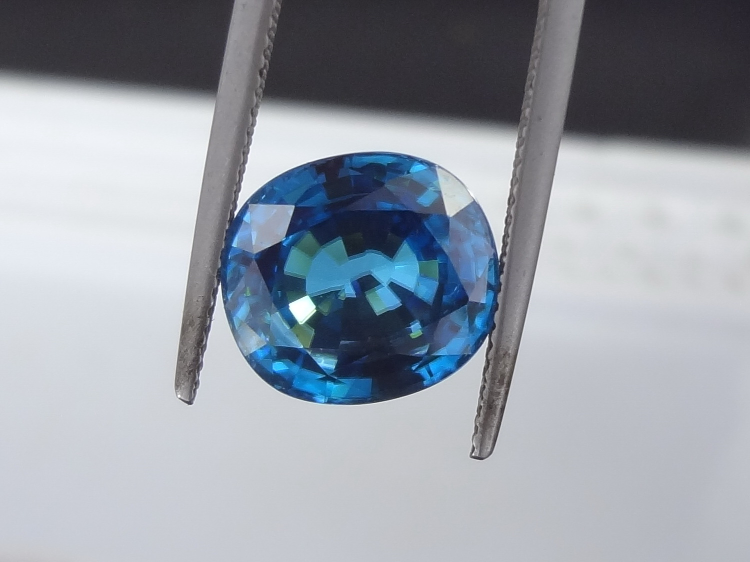 Extra large Blue Zircon from Cambodia for Sale with great peacock blue colour. This Zircon is completely spotless, perfectly clean (FL) and cut in a Cushion shape.